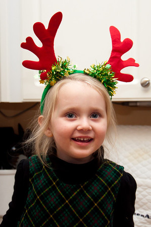 She put on her reindeer antlers to help me make cookies for Santa.